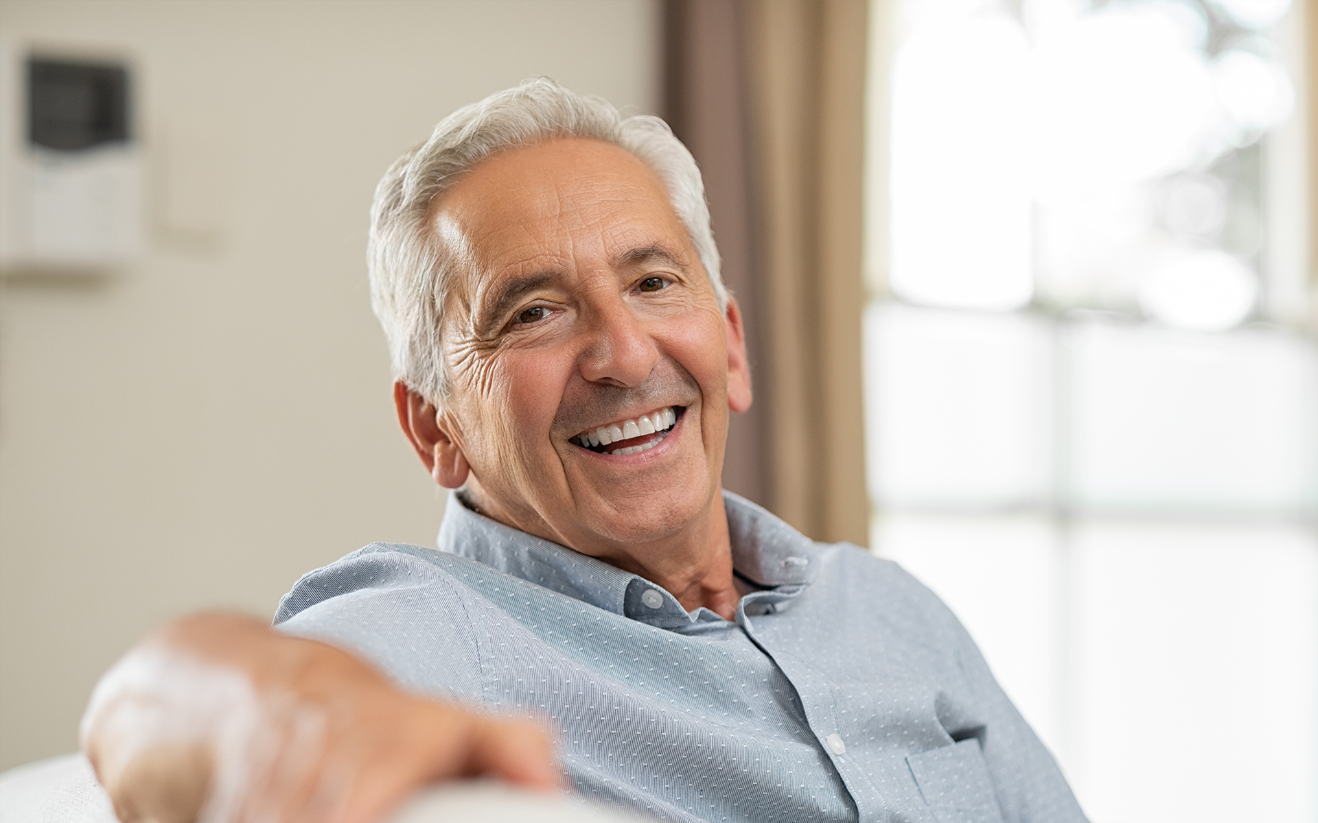 smiling older gentleman with face wrinkles